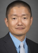 A portrait of Prof. Xi Zhu of the Department of Health Management and Policy at the University of Iowa College of Public Health.