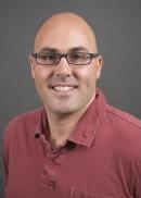 A portrait of David Zahrieh of the University of Iowa College of Public Health.