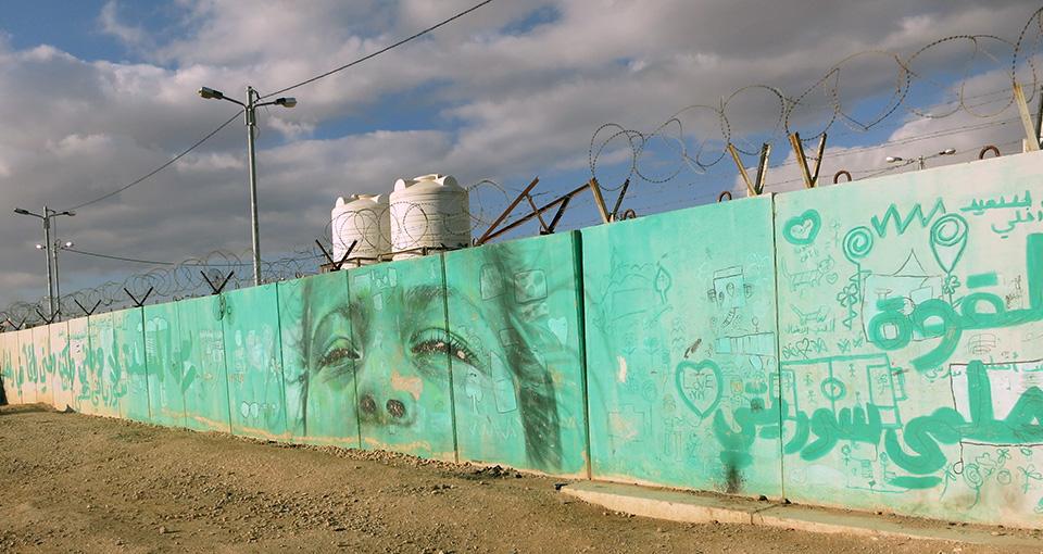Photo of the fence surrounding Zaatari refugee camp in Jordan
