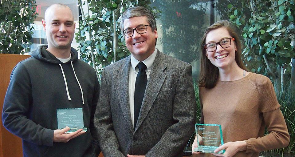 2017 Leon Burmeister Scholarship recipients Brandon Butcher and Monica Ahrens with Biostatistics Head Joe Cavanaugh.