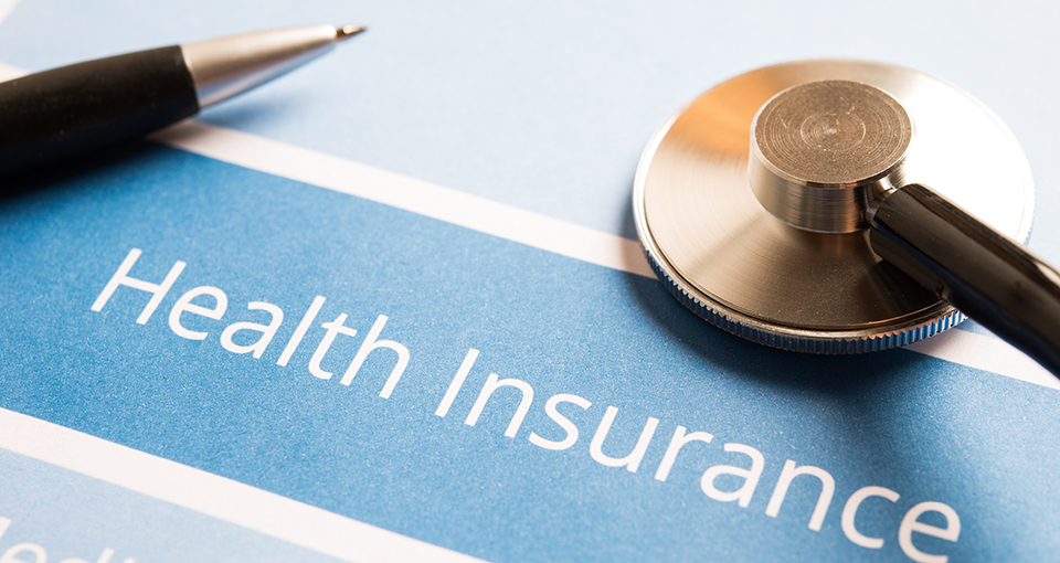 Health insurance form and pen