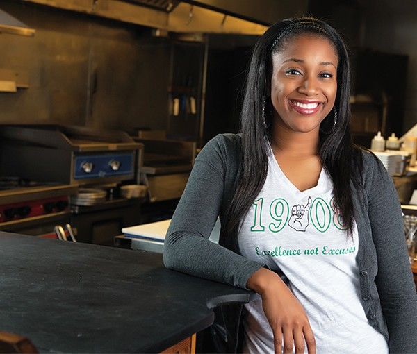 Deirdre R. Green, who earned her MS in Industrial Hygiene from the Department of Occupational and Environmental Health in 2014, poses in a restaurant.