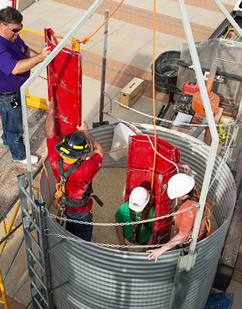 Students in the agricultural medicine course conduct a simulated grain bin rescue.