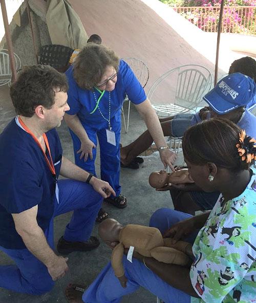 Jeff Dawson and Joyce Cragun demonstrating infant Heimlich maneuvers to caregivers