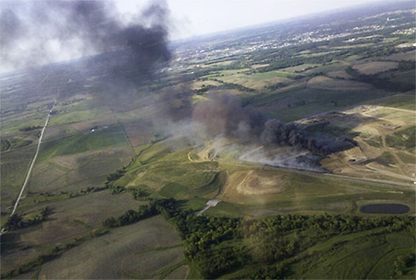 An aerial view of the 2012 Iowa City landfill fire, with smoke primarily from the burning shredded tire drainage layer.