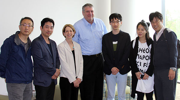 photo of Bill Field and Dean Sue Curry with South Korean visitors
