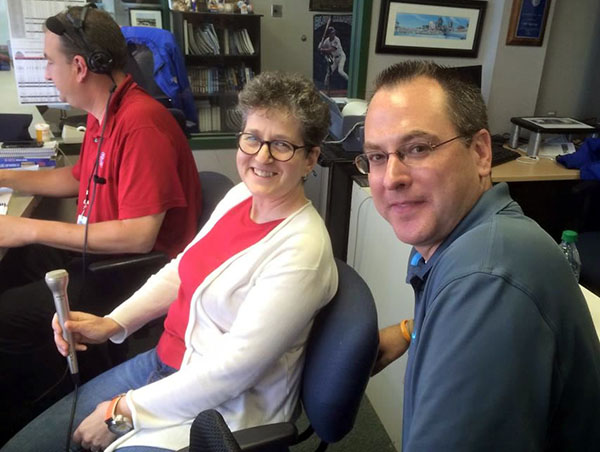 photo of Laurie Gutmann and Chris Coffey in the Iowa Cubs broadcast booth.