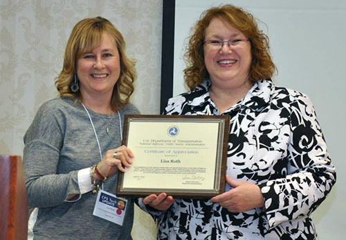 photo of Lisa Roth with award