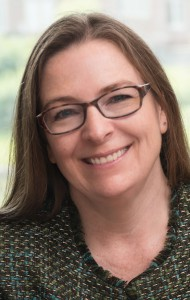 A portrait of Corinne Peek-Asa, Associate Dean for Research and Professor of Occupational and Environmental Health at the University of Iowa College of Public Health.