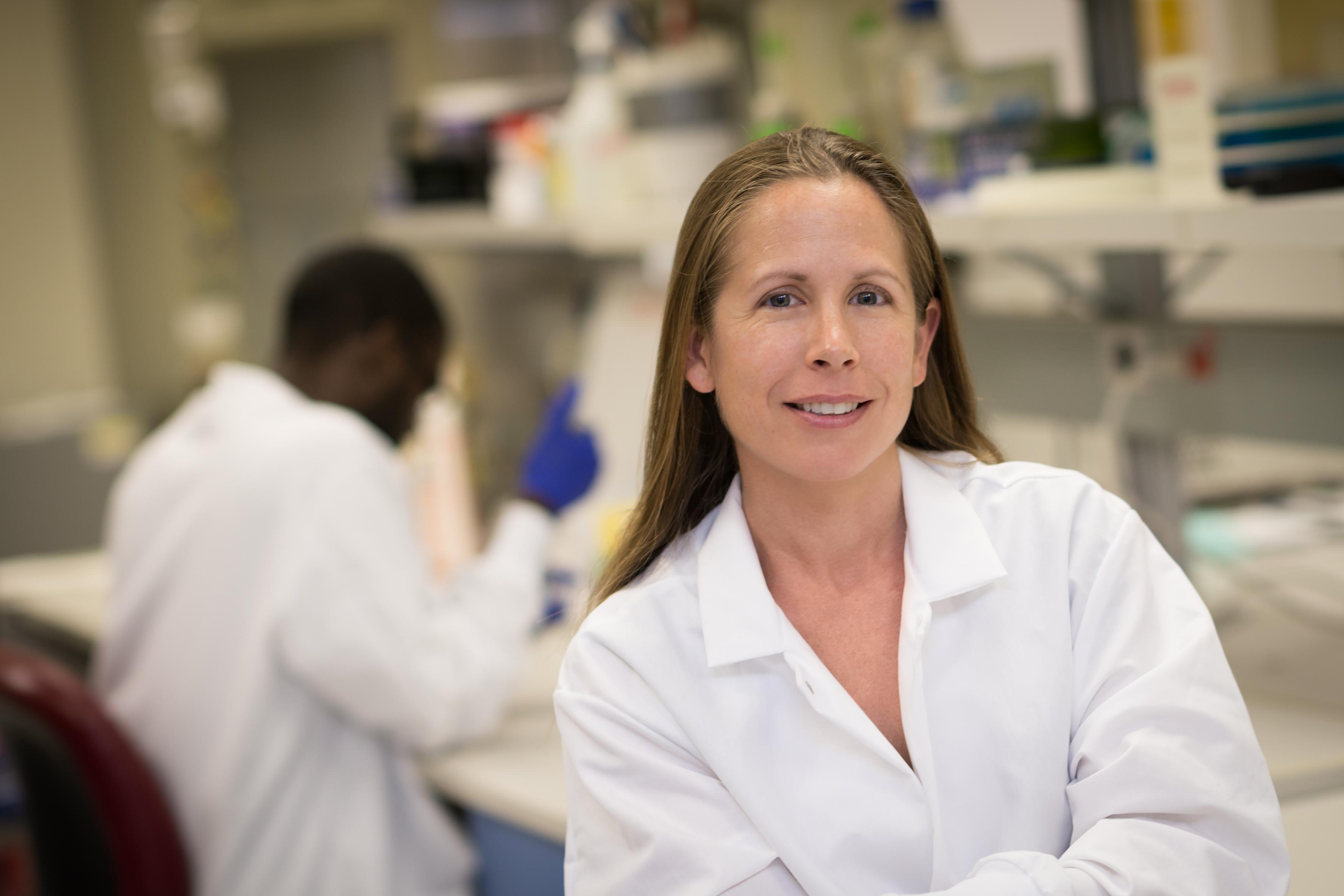 Portrait of Dr. Kelly Baker in her lab
