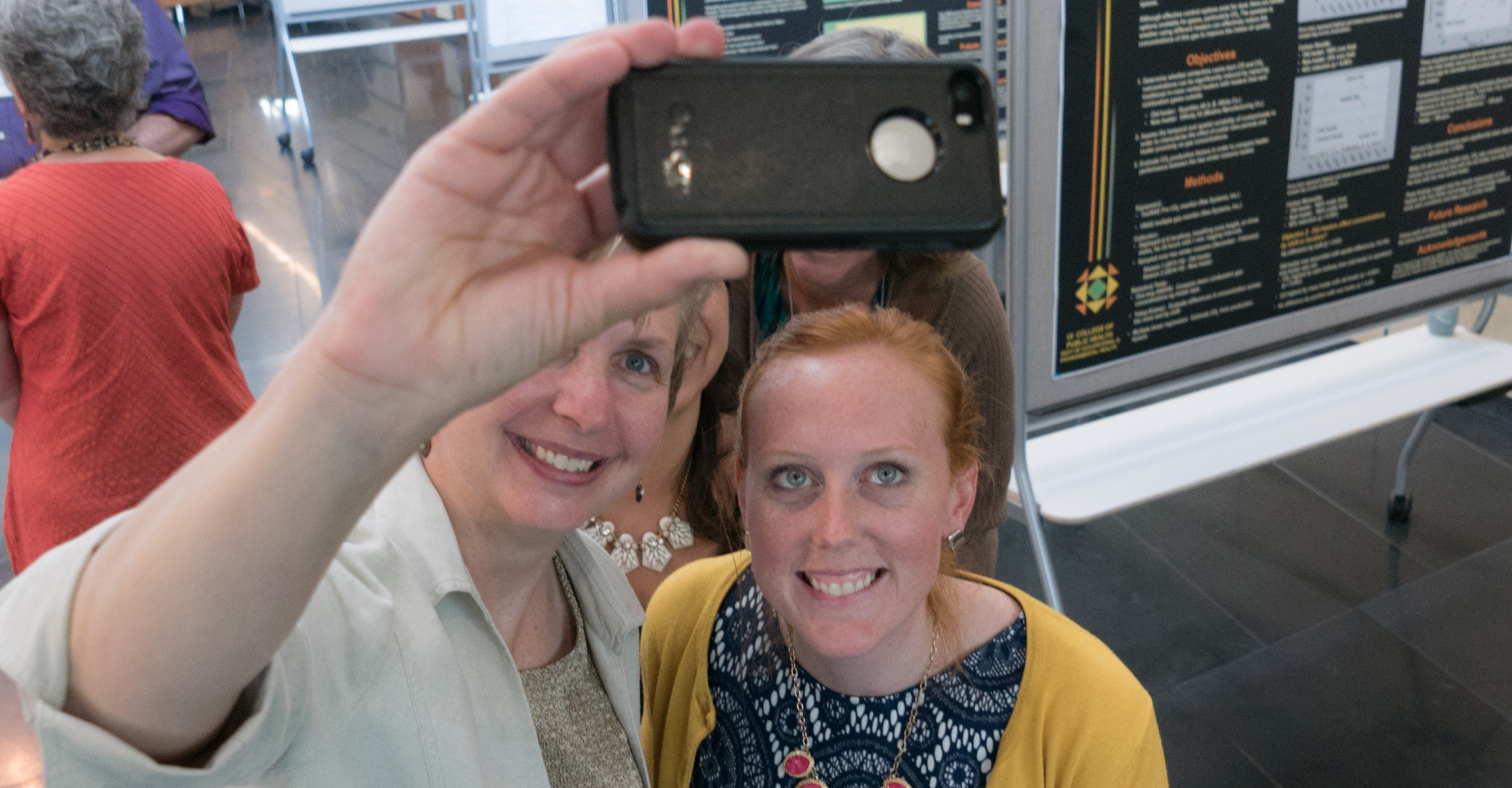 Prof. Diane Rohlman and PhD student Josie Rudolphi pose for a selfie at a recent poster session at the University of Iowa College of Public Health.