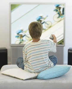 Boy sitting in living room watching television