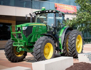 A tractor on display outside of the College of Public Health.