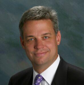A portrait of Eric Neu, Business Leadership Network Steering Committee Member.