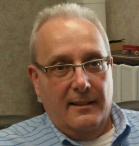A portrait of Greg Fenton, Business Leadership Network Steering Committee Member.