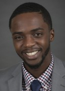 A portrait of Charles Ajayi of the Department of Health Management and Policy in the College of Public Health at the University of Iowa.