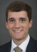 A portrait of Tyler Bennett of the Department of Health Management and Policy in the College of Public Health at the University of Iowa.