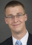 A portrait of Matthew Bergs of the Department of Health Management and Policy in the College of Public Health at the University of Iowa.