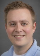 A portrait of Corey Boles of the Department of Occupational and Environmental Health in the College of Public Health at the University of Iowa.