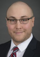 A portrait of Jace Brady of the Department of Health Management and Policy in the College of Public Health at the University of Iowa.