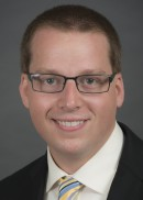 A portrait of Christopher Carter of the Department of Health Management and Policy in the College of Public Health at the University of Iowa.