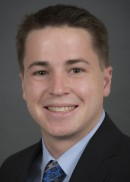 A portrait of Matthew Knoedel of the Department of Health Management and Policy in the College of Public Health at the University of Iowa.
