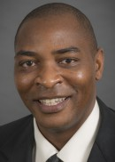 A portrait of Chibuike Obioha of the Department of Occupational and Environmental Health in the College of Public Health at the University of Iowa.