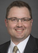 A portrait of Todd j. Patterson of the Department of Health Management and Policy in the College of Public Health at the University of Iowa.