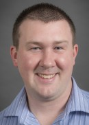 A portrait of Aron T. Thedell of the Department of Occupational and Environmental Health in the College of Public Health at the University of Iowa.