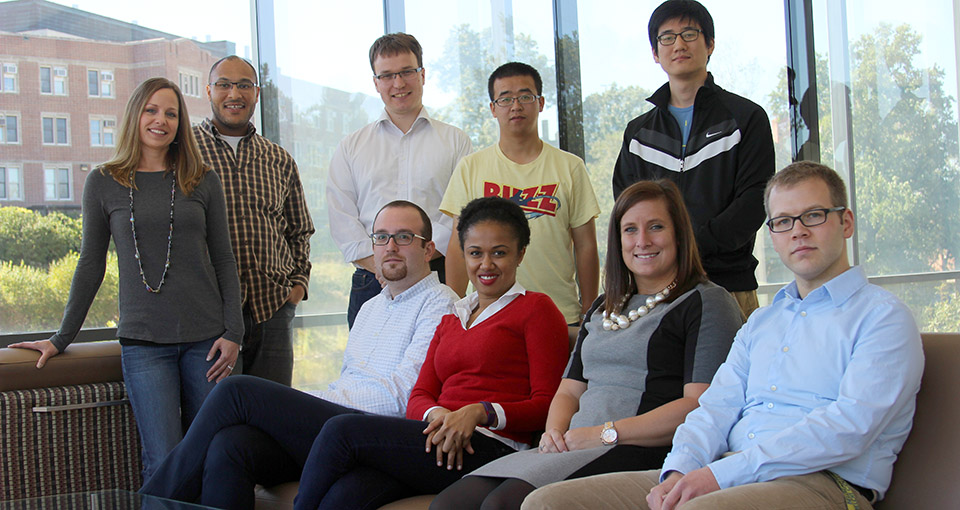 Students in the Health Management and Policy PhD program pose in the student commons area.
