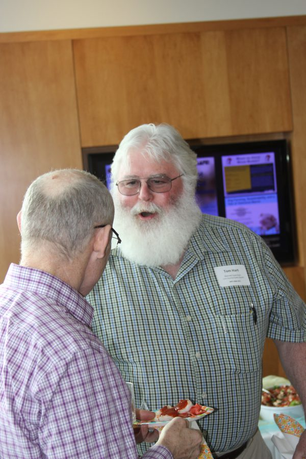 Occupational and Environmental Health alumnus Tom Hart chats with department head Peter Thorne.