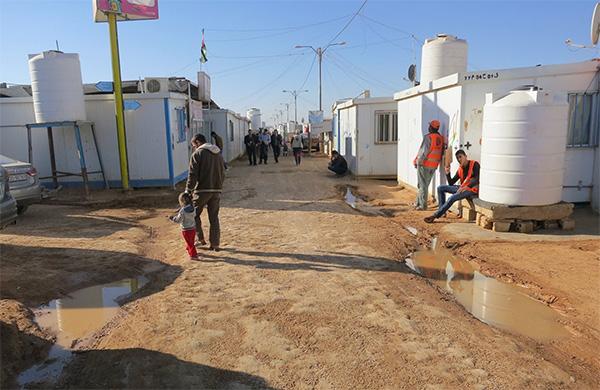 A muddy street in Zaatari refugee camp