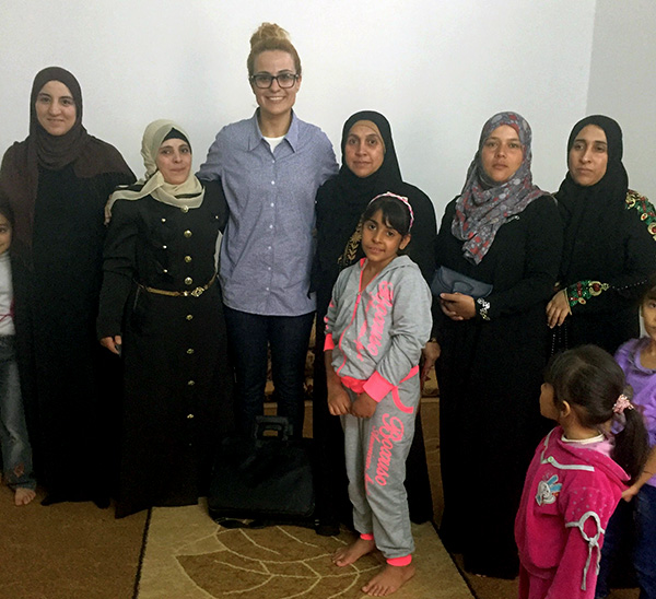 Tala Al-Rousan meeting with women and children refugees