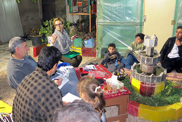 Tala Al-Rousan meeting with refugees to discuss health concerns