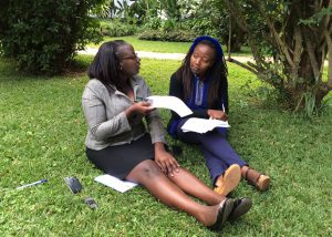 Two research assistants conduct a mock interview using the HIV patient satisfaction survey instrument.