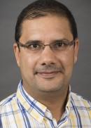 A portrait of Ali Al Jumaili of the University of Iowa College of Public Health.