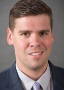 A portrait of Colin Carroll of the University of Iowa College of Public Health.