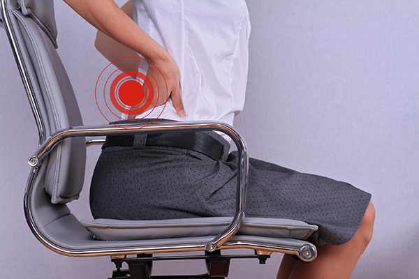 photo of woman with back pain