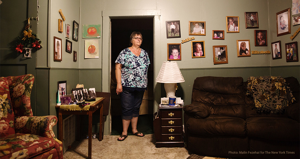 A woman stands in her living room