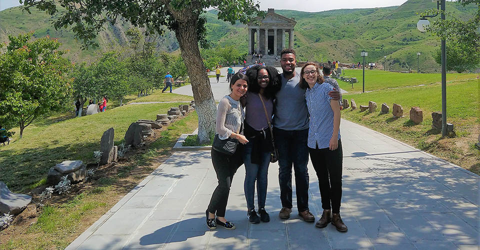 a group of four MHIRT students in Romania