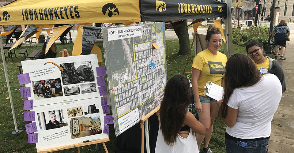 UI students talking with Mason City residents