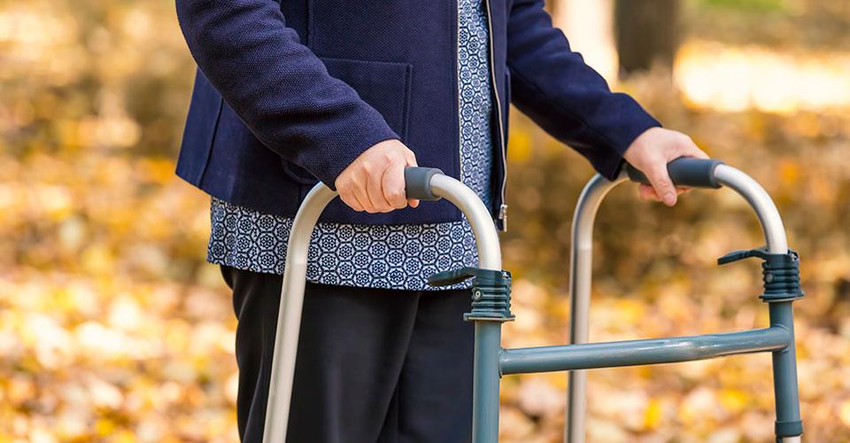 photo of an older woman using a walker