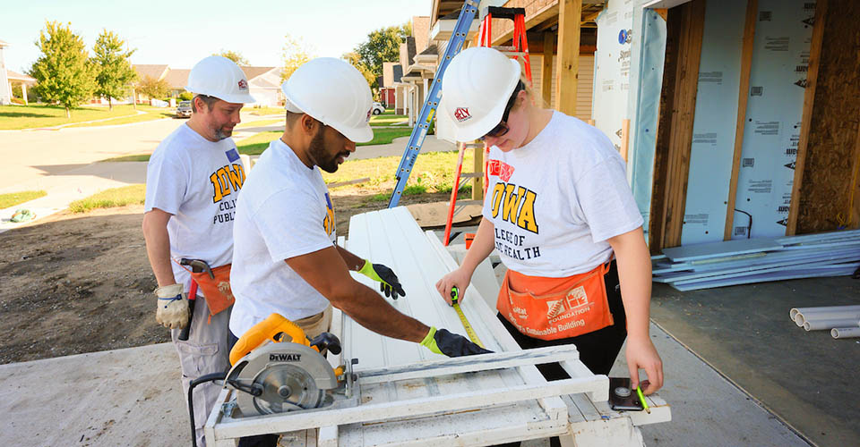 CPH students working on a Habitat for Humanity construction site