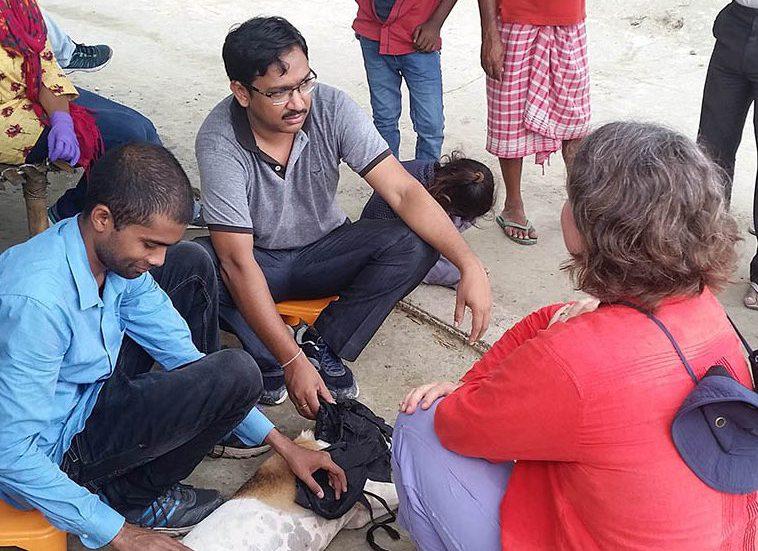 Dr. Christy Petersen speaking with men in India