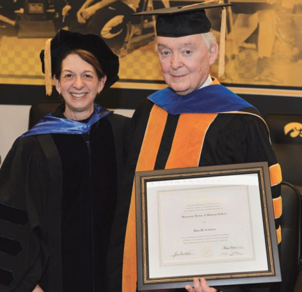 John W. Colloton receives an honorary degree from the University of Iowa College of Public Health in 2013.