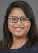 Portrait of Mina Shrestha, PhD student in the Department of Health Management and Policy.