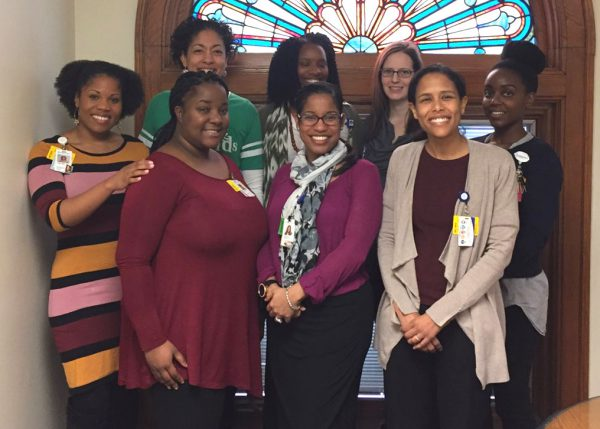 Bottom row (left to right): Amber Adams (clinical trials coordinator), Dr. Trista Perez-Crawford, and Dr. Briana Woods-Jaeger. Top row (left to right): Dr. Tiffany Willis, Dr. Amy Beck, Angelique Foye (research assistant), Emily Siedlik (data analyst), and Ayanda Chakawa (clinical psychologist intern).
