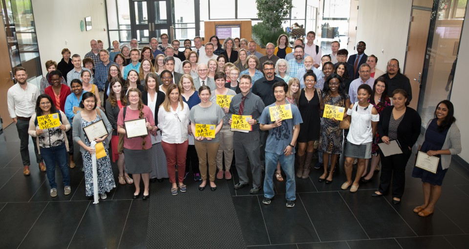 College of Public Health students, faculty and staff pose in the CPHB atrium in May 2018.