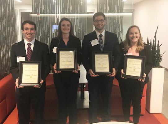 group photo of Iowa MHA students at U Kansas case competition