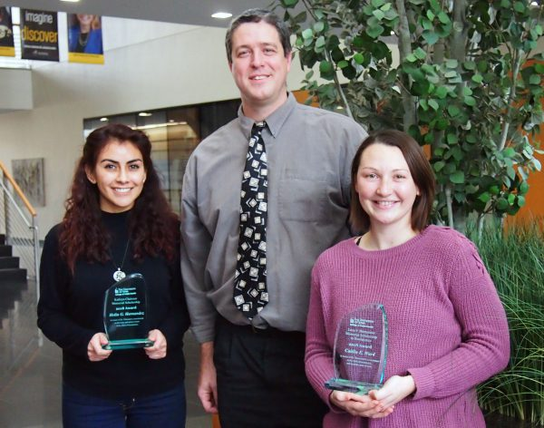 Graduate students Helin Hernandez (left) and Caitlin Ward (right) with Professor Jake Oleson